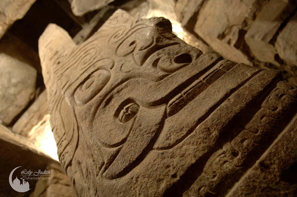 photograph-of-the-intricate-carvings-on-the-lanzon-stela-which-protrudes-through-the-gallery-ceiling-building-b-1